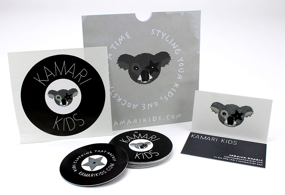 The business cards are multi level 2 color letterpress printed and combined with a shiny black foil stamp on the koalas star to contrast the matte white